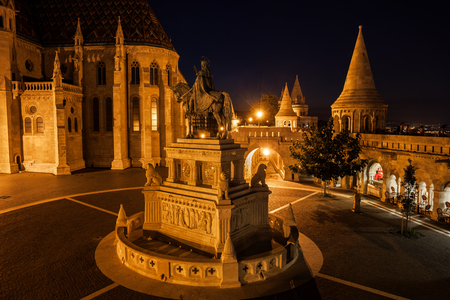 City of Budapest in Hungary at night, King St. Stephen (1906) monument, Matthias Church and Fisherman Bastion, Holy Trinity Square