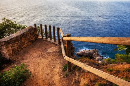 Small cosy viewpoint terrace on cliff top ovelooking the Mediterranean Sea at Costa Brava, Catalonia, Spain