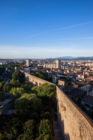 City of Girona cityscape with Passeig de la Muralla, old city wall fortification, Catalonia, Spain Stock Photo