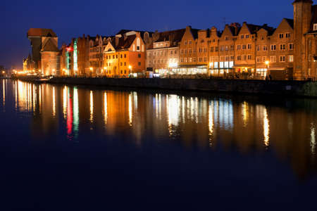 City of Gdansk at night in Poland, Old Town skyline river view.