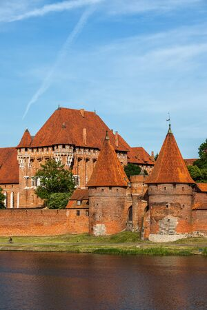 The Malbork Castle in Poland, medieval brick fortification at the Nogat River.