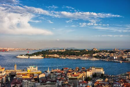 Istanbul city at sunset in Turkey, view from Beyoglu over Golden Horn to Sultanahmet district.