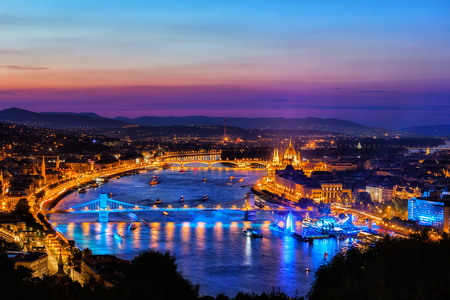 Blue hour in city of Budapest by the Danube River, tranquil twilight evening in capital city of Hungary.