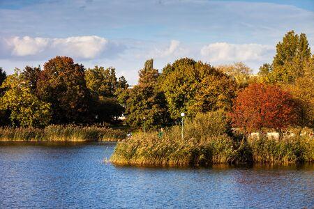 Autumn trees and lake in Szczesliwicki Park in Ochota district of Warsaw city in Poland