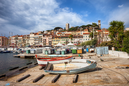 Cannes city skyline on French Riviera in France, Le Suquet old town from quay of Le Vieux port
