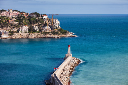 City of Nice in France, pier on Mediterranean Sea with Phare de Nice lighthouse on French Riviera, view from above.