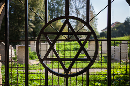 Star of David symbol on cemetary fence in Jewish Quarter of Kazimierz in Krakow, Poland