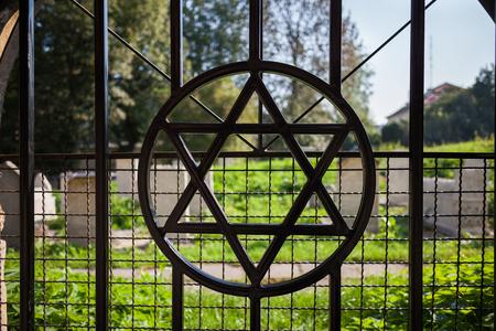 Star of David symbol on cemetary fence in Jewish Quarter of Kazimierz in Krakow, Poland