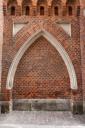 Gothic arch niche in brick wall, fortification in Old Town of Krakow city in Poland.