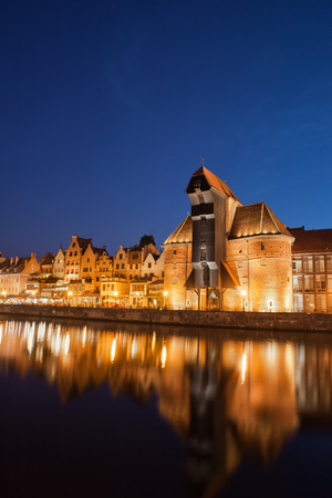 Old Town of Gdansk at night in Poland, city skyline with reflection in Motlawa River. Фото со стока - 114903183