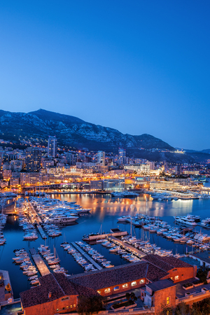 Monaco in the evening, view above port to Monte Carlo.