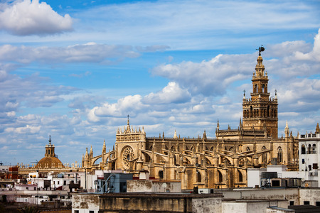 Spain, Andalusia, city of Seville, Cathedral of Saint Mary of the See (Spanish: Catedral de Santa Maria de la Sede) in Old Town skyline, Gothic style architecture Stock Photo