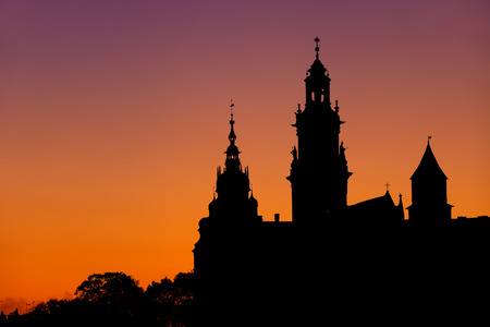 Wawel Royal Castle and Cathedral silhouette at evening twilight in city of Krakow in Poland.
