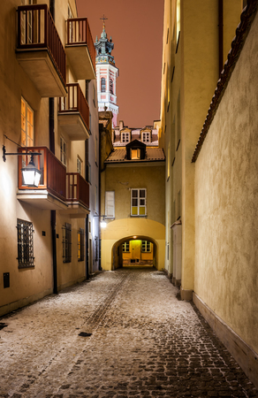 Street on winter night in Old Town of Warsaw city in Poland
