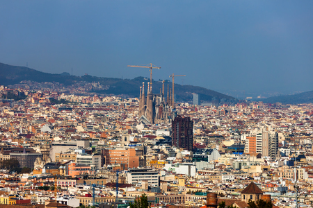 Barcelona city aerial view in Catalonia, Spain, cityscape with the Sagrada Familia at the middle far end.
