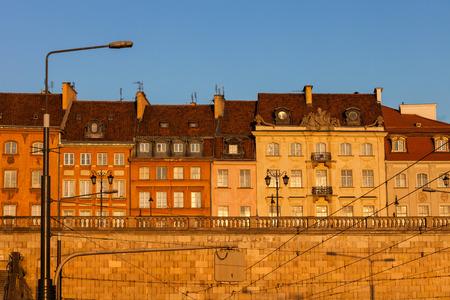 City of Warsaw in Poland, row of historic houses at sunrise on Krakowskie Przedmiescie street.
