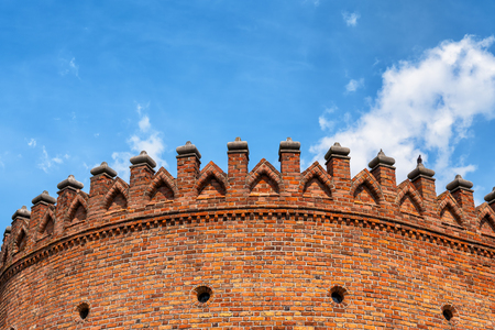 Barbican fortification battlement against blue sky, old town of Warsaw in Poland, architectural detail of fortified gateway, top part closeup.