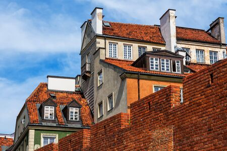 Warsaw Old Town houses behind city wall fortification in Poland.