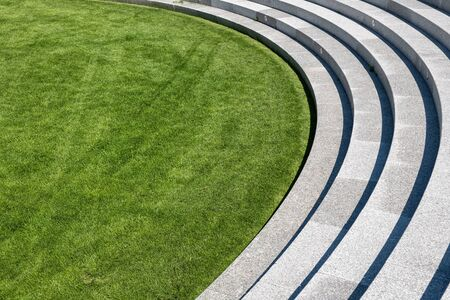 Freshly cut, well maintained lawn, curved stairs to the green grass abstract. 写真素材