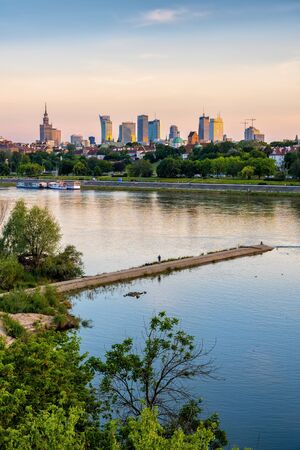 City of Warsaw river view at sunset in Poland.
