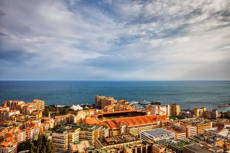 Monaco principality cityscape, aerial view with stadium in the middle, horizon of the Mediterranean Sea Stock Photo