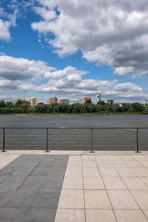 Boulevard at Vistula River in city of Warsaw in Poland, riverside promenade, view to Praga district.
