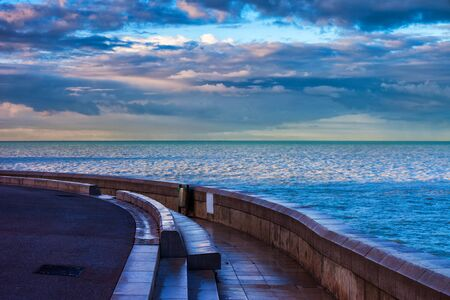 French Riviera waterfront at sunrise along Mediterranean Sea in city of Nice in France