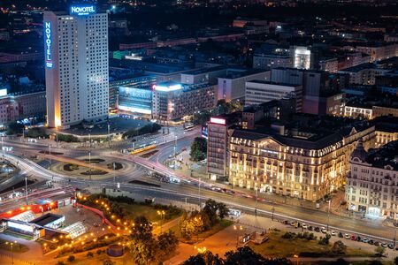 Warsaw, Poland - June 14, 2019: Dmowski Roundabout (Rondo Dmowskiego) and Jerusalem Avenue (Aleje Jerozolimskie) aerial view in the city center at night