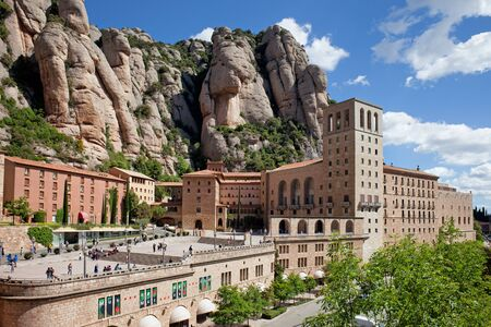 Catalonia, Spain - May 23, 2019: Santa Maria de Montserrat monastery and mountains, famous pilgrimage site.