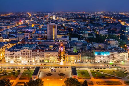 City of Warsaw in Poland, aerial view cityscape at night, view over the Jerusalem Avenue (Polish: Aleje Jerozolimskie).