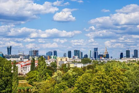Warsaw skyline, capital city of Poland, view above park trees.