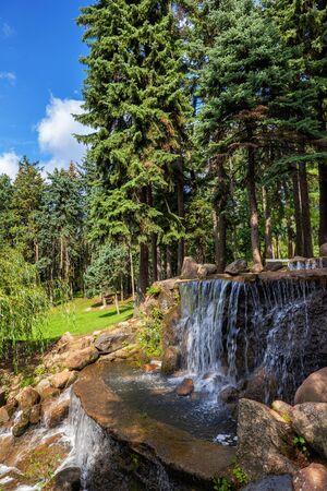 Landscape with cascading waterfall in scenic Skaryszewski Park in Warsaw in Poland.
