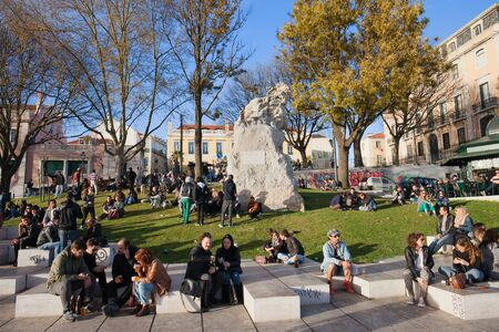 Lisbon, Portugal - March 22, 2014: People relax at Miradouro de Santa Catarina terrace and garden, popular meeting place in the city