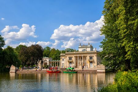 Warsaw, Poland - August 9, 2019: Palace on the Isle and lake in Royal Lazienki Park, Neoclassical  style city landmark