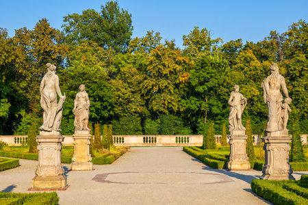 Warsaw, Poland - August 27, 2019: Sculptures in Baroque royal garden of Wilanow Palace, residence of King John III Sobieski. Редакционное