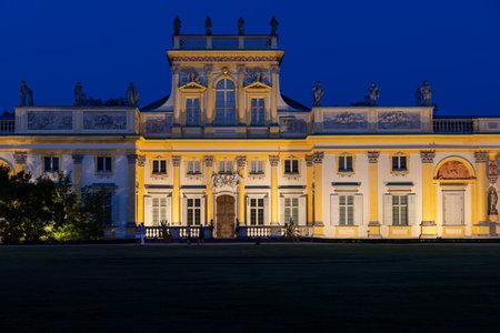 Warsaw, Poland - August 27, 2019: Wilanow Palace (Polish: Palac w Wilanowie) illuminated at night, Baroque royal residence of King John III Sobieski, 17th century city landmark. Редакционное
