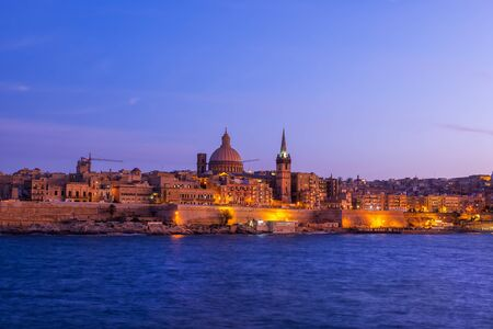 Fortified old city of Valletta in the evening in Malta, skyline from the sea.