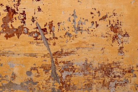 Old, vintage orange painted wall with red paint below, aged, retro background or texture Standard-Bild - 133669337