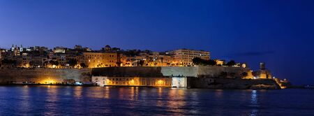 Panorama of the Valletta city at night in Malta, capital of an island country in the Mediterranean Sea