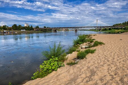 Sandy beach on Vistula river shore in city of Warsaw in Poland.