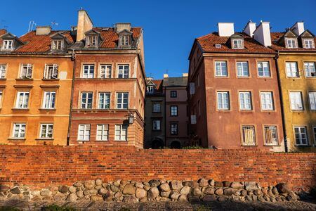 Historic tenement houses and city wall in Old Town of Warsaw in Poland.