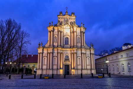Carmelite Church of the Assumption of the Virgin Mary and St. Joseph illuminated at night in Warsaw, Poland, Neoclassical style architecture.