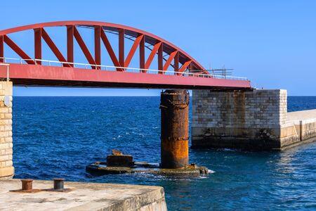 The St Elmo Bridge or Breakwater Bridge, single-span arched truss steel sea footbridge in Valletta, Malta