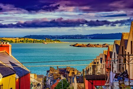 Picturesque town of Cobh at sunset in Ireland, traditional houses with view to Cork Harbour