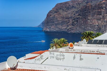 Cliffs and town of Los Gigantes on the Atlantic Ocean in Tenerife, Canary Islands, Spain Stok Fotoğraf