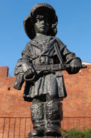 Warsaw, Poland - Circa June, 2020: Monument to the Little Insurgent in the Old Town, designed in 1946 by Jerzy Jarnuszkiewicz, statue to commemorate child soldiers who fought and died during the Warsaw Uprising of 1944