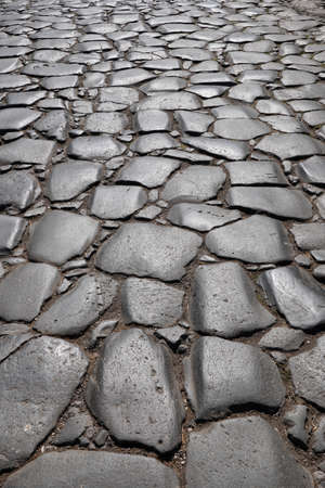 Via Sacra, main street of ancient city of Rome in Italy, centuries old smooth stones background 版權商用圖片