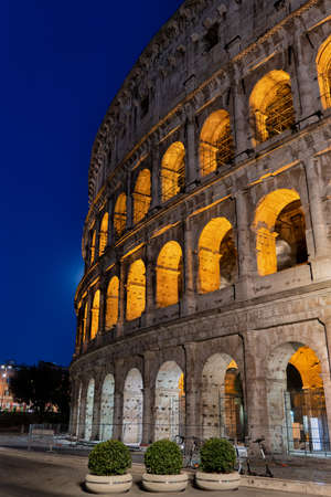 The Colosseum at night in Rome, Italy, ancient Flavian Amphitheater and gladiators stadium, city landmark 写真素材