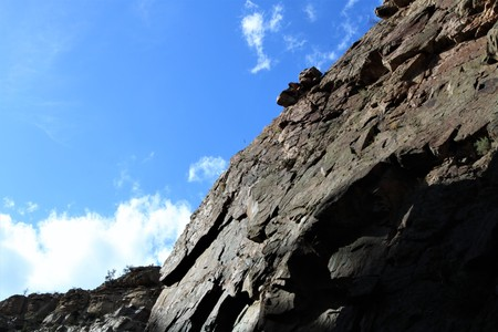 A Rock Wall and the Sky Stock Photo
