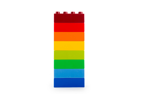 A rainbow color lego blocks on white background